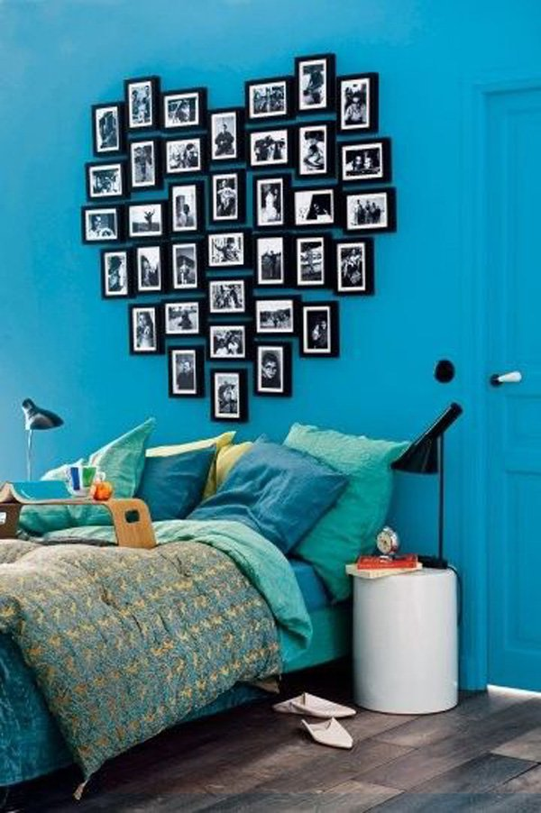 turquoise-bedroom-with-heart-shaped-headboard-made-out-of-picture-frames